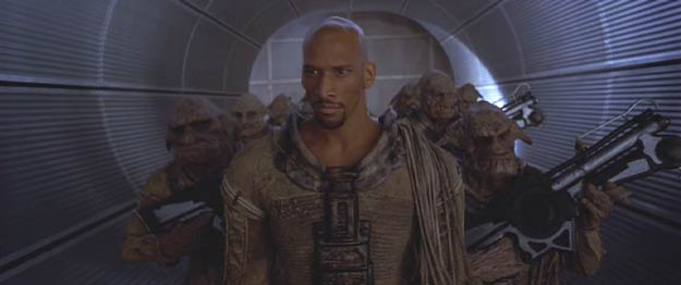 The Fifth Element: The Mangalore Aknot, in human form (played by Vladimir McCrary), and his soldiers are on their way to make a  business deal.