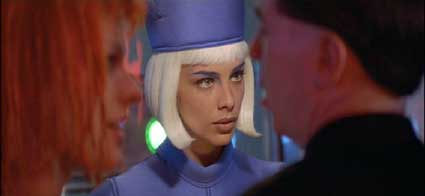 The Fifth Element: LeeLoo and David checking in at the airport (Sophia Goth as the attendant.)