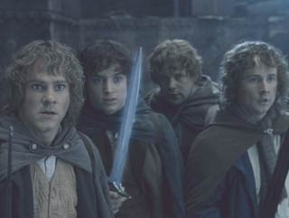 Lord of the Rings: The Fellowship of the Ring: The hobbits steel themselves against whatever is about to come through the doors.