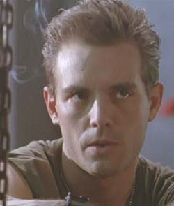 Aliens: Corporal Dwayne Hicks (Michael Biehn) looks on during the briefing.