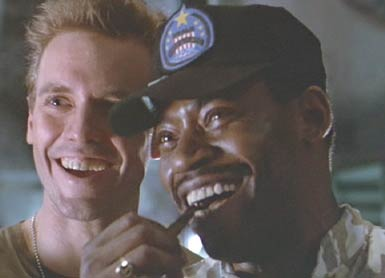 Aliens: Hicks and Apone (Al Matthews), grinning in surprise at the way Ripley handles herself.