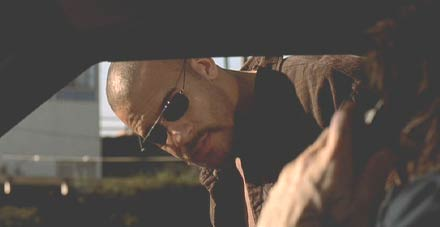 A Man Apart: Vin Diesel framed by the car window.
