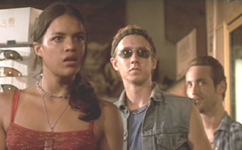 The Fast and the Furious: Letty, Jesse (Chad Lindberg) and Leon (Johnny Strong) look on as Dom goes after Vince.