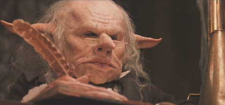 Harry Potter and the Sorcerer's Stone: Warwick Davis as a Goblin bank teller. Too bad the great little people in movies are usually covered in foam latex.