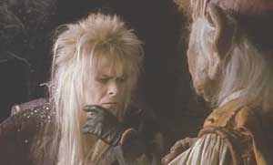 Labyrinth: Jareth examines the bracelet, a present from Sarah, and questions Hoggle's loyalty.
