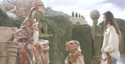 Labyrinth: Sarah and Hoggle consult the Wiseman (and his talking hat) for directions.