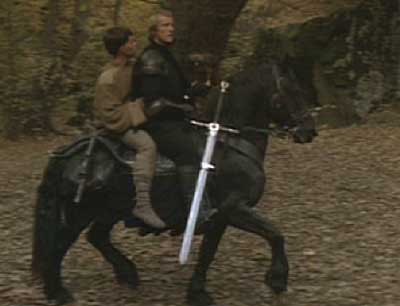Ladyhawke: Navarre and the Mouse ride through the forest.