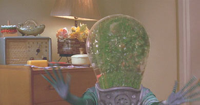 Mars Attacks: The Martian downfall: their heads explode when they hear Slim Whitman sing. Ritchie and his grandma will save the world.