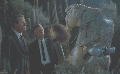 Men in Black: K and D (Richard Hamilton) interrogate Mikey.