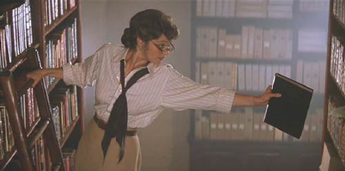 The Mummy (1999): Egyptologist/librarian Evie' Carnahan throwing herself into her work.