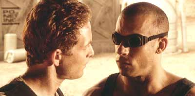 Pitch Black: Johns reminds Riddick that he's on a short leash.