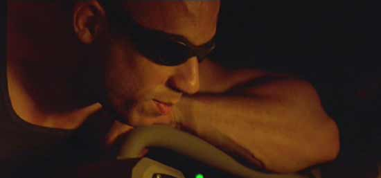 Pitch Black: Riddick can tell he's getting to Carolyn; he savors the moment.