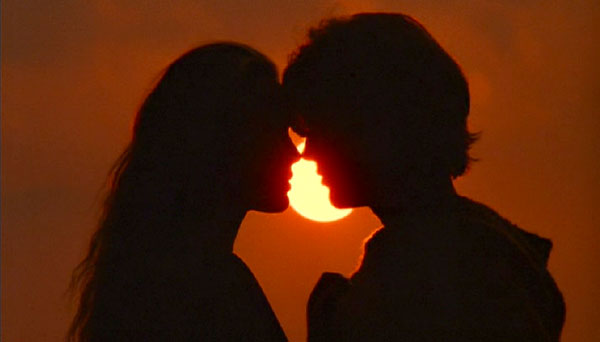 The Princess Bride: Buttercup and Westley kissing at sunset.