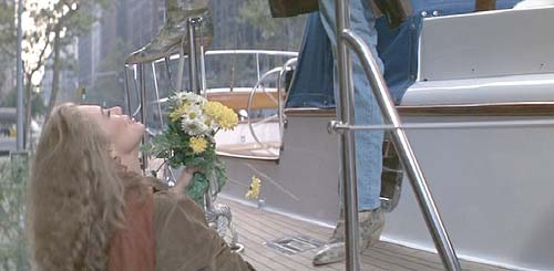 Romancing the Stone: Jack welcomes Joan aboard the Angelina Columbia.