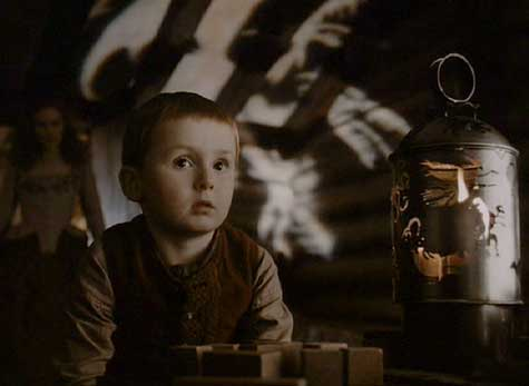 Sleepy Hollow: The Midwife's son watching the play of light from a lantern.
