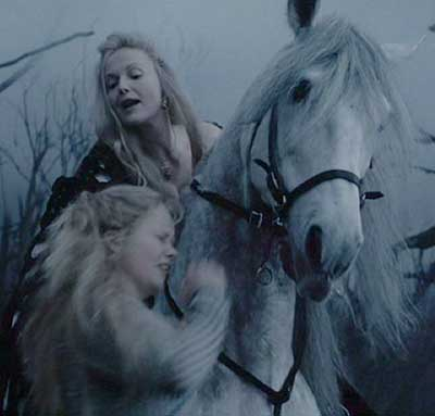 Sleepy Hollow: Lady Van Tassel restrains Katrina for the Horseman.