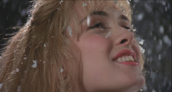 Edward Scissorhands: Kim Bogs (Winona Ryder) twirls in the snow created by Edward's ice sculpting.
