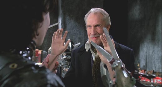 Edward Scissorhands: The inventor presents Edward with his new hands.
