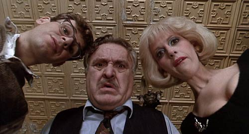 Little Shop of Horrors (1986): Seymour (Rick Moranis), Mr. Mushnik (Vincent Gardenia) and Audrey (Ellen Greene) peer at Seymour's strange and unusual plant.
