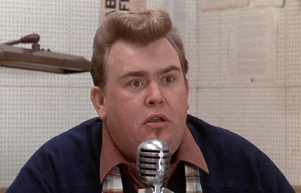 Little Shop of Horrors (1986): John Candy as disc jockey, Weird Wink Wilkinson.