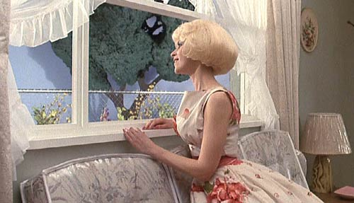 Little Shop of Horrors (1986): Audrey dreams of a perfect little house in the suburbs.