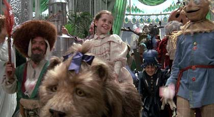 Return to Oz: The restored citzens of the Emerald City celebrate Dorothy's victory.  Notice the Cowardly Lion and the Tin Woodsman make an appearance.