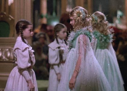 Return to Oz: Dorothy helps Ozma escape from Mombi's enchantment which has imprisoned her in the mirror.