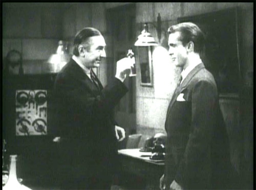 The Devil Bat: Carruthers' first victim, Roy Heath (John Ellis), innocently accepting the shaving lotion of death.